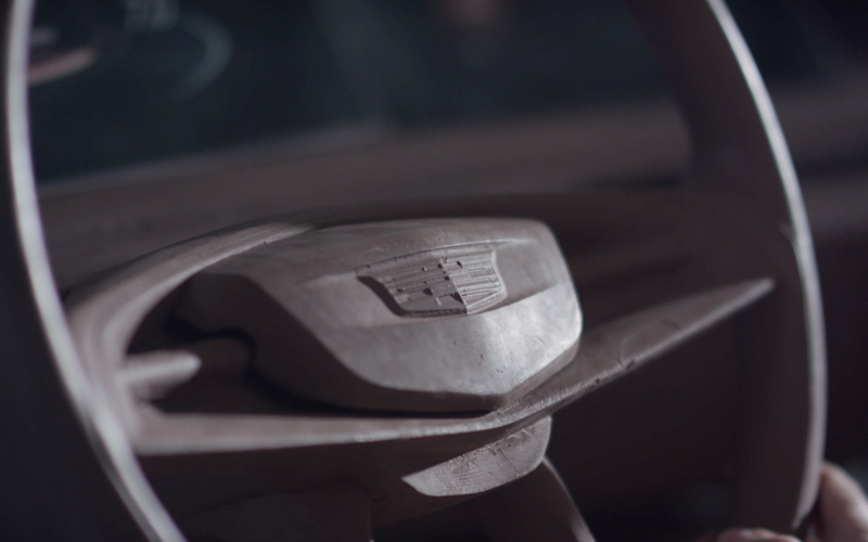 The steering wheel of a Cadillac car sculpted from clay