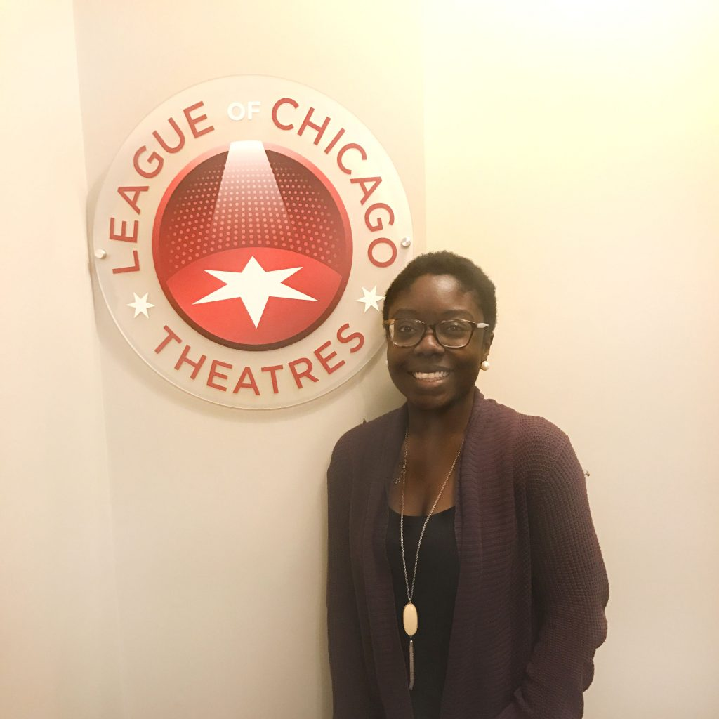 Adia Alli in front of League of Chicago Theatres sign