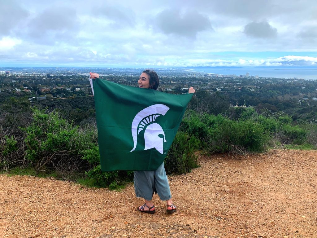 a girl holding the spartan flag