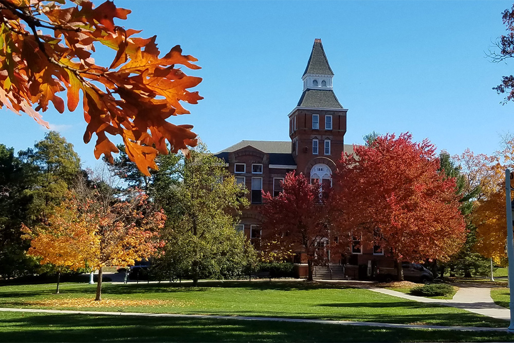 Linton hall surrounded by trees in the fall
