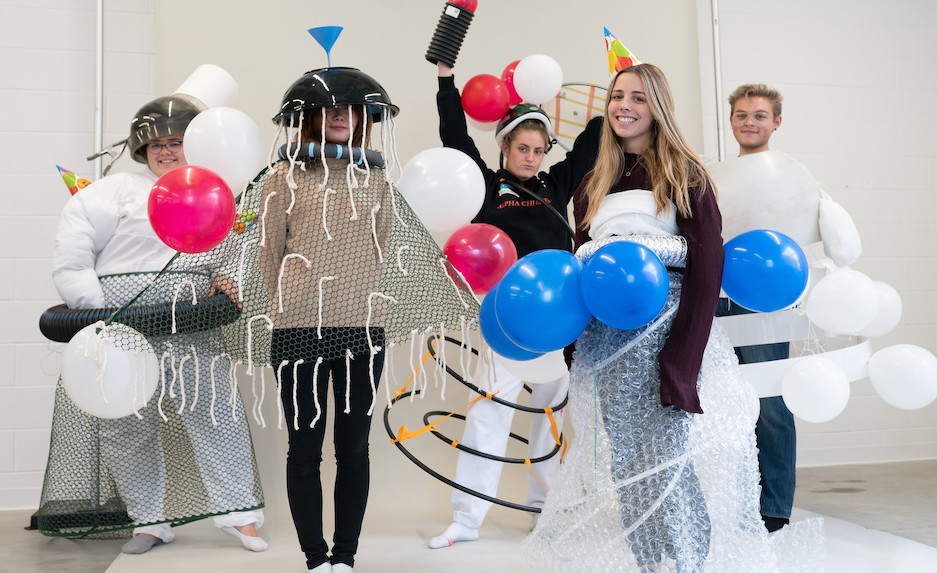 group of five people dressed up in costumes made from funnels, bubble wrap, balloons, and mesh
