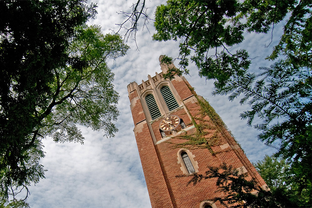 looking up at beaumont tower and green trees