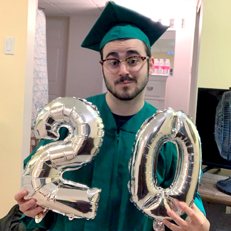 photo of a man wearing a green cap and gown with glasses holding 20 balloons