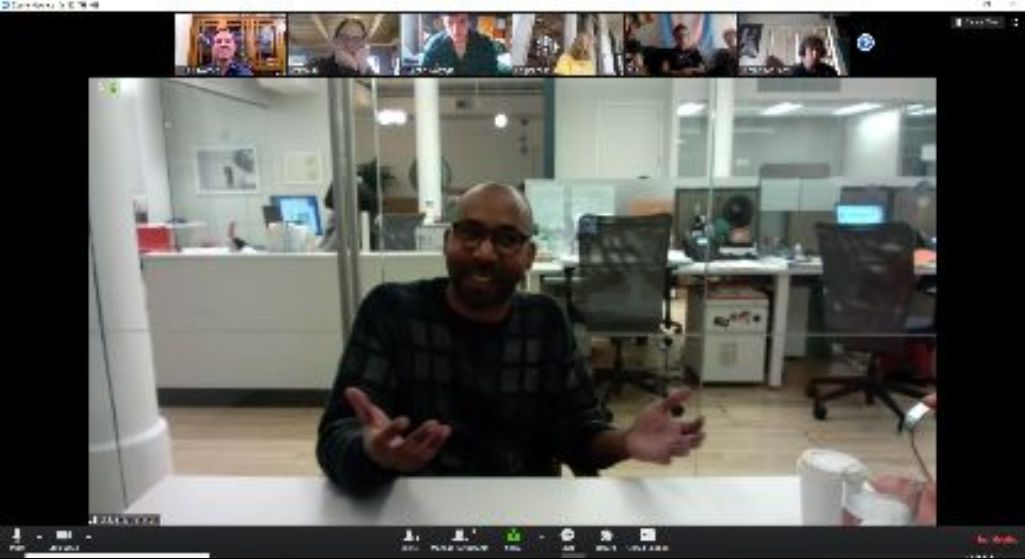alumni speaking to others on an online video call