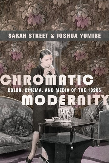 book cover of chromatic modernity, woman is smoking behind an end table