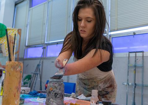 No Hands, No Limits, No Problem for Graduating Studio Art Senior
