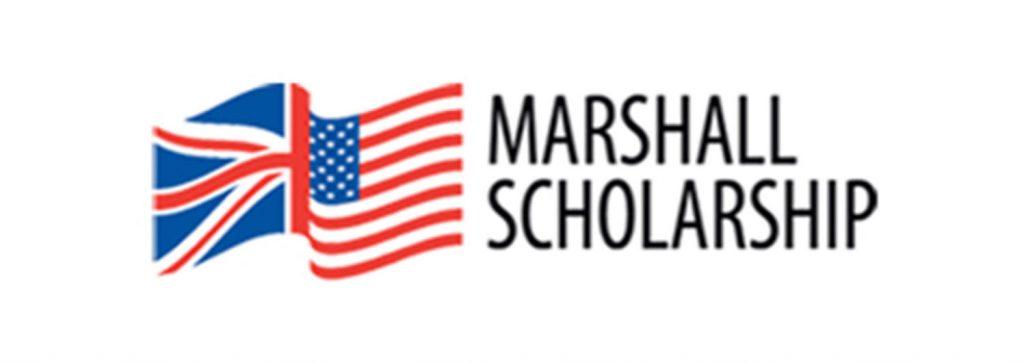 a Marshall scholarship sign with a flag