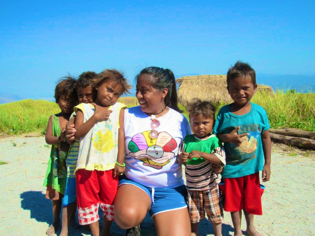 woman with a group of five children