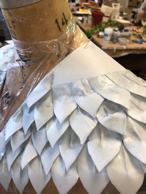 White feather shoulder piece for a costume