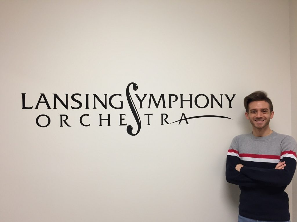 a man standing in front of a Lansing Symphony Orchestra