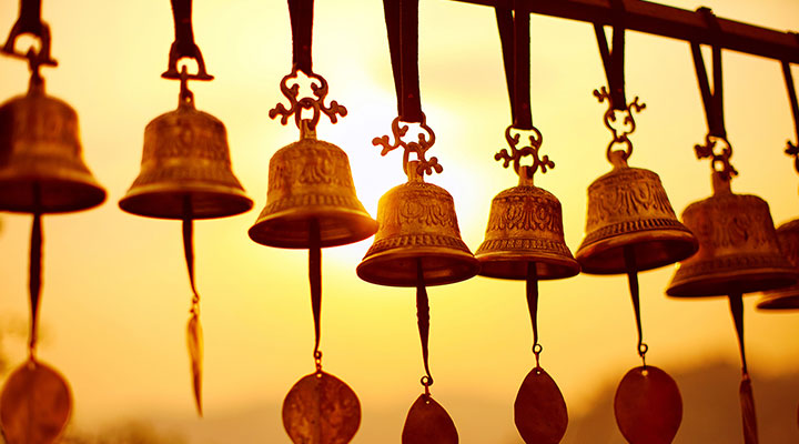 gold bells along a line during sunset