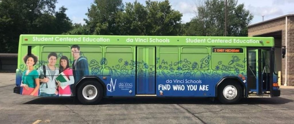 Green and blue bus designed by Kelly Phalen