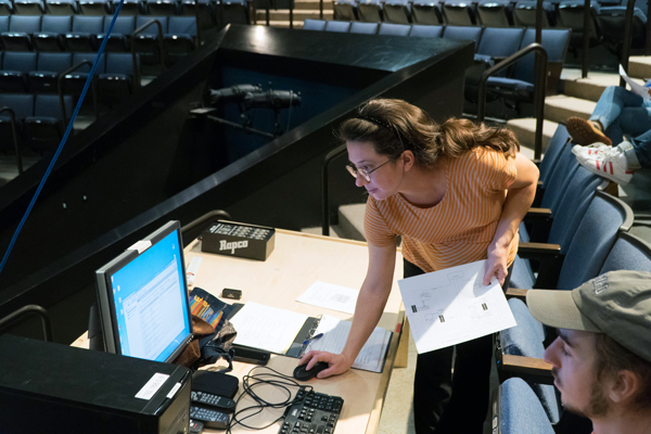 Allison Dobbins works on cueing software for media