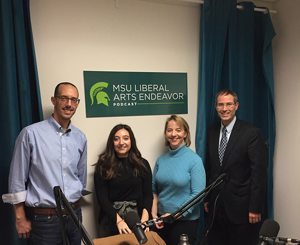image of 2 women and 2 men posing for picture in the liberal arts endeavor podcast studio