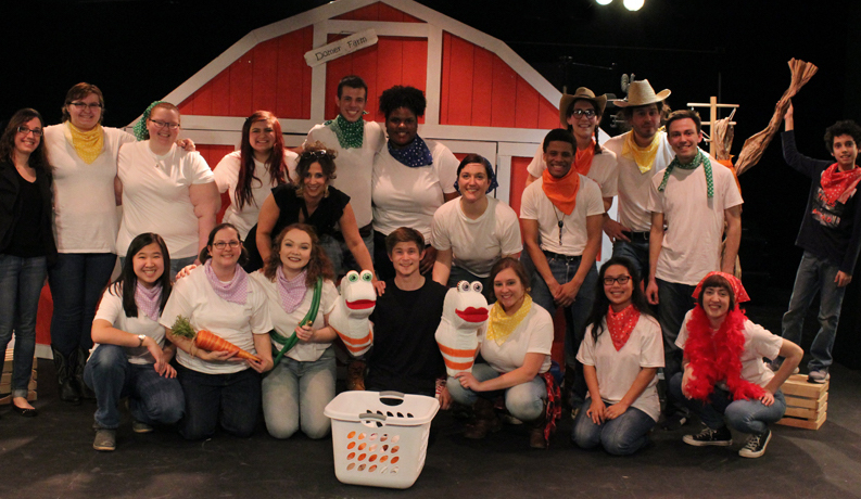 a group of students dressed like farm animals standing in front of a barn
