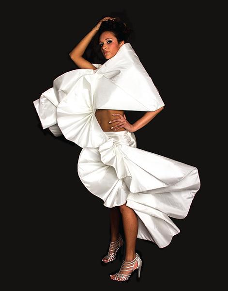 model displaying white avant garde fashion design
