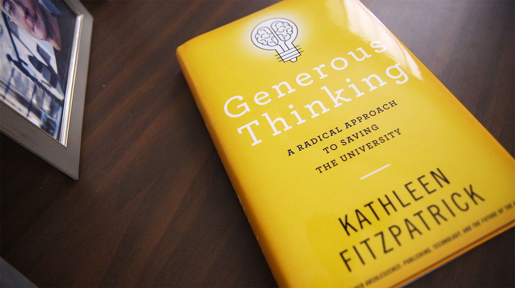 book with a yellow cover that says Generous Thinking on it and a lightbulb