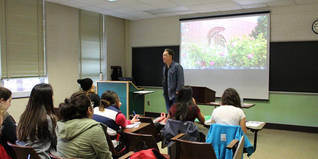 David Gonzalez speaking to students at Eastern High School in Lansing
