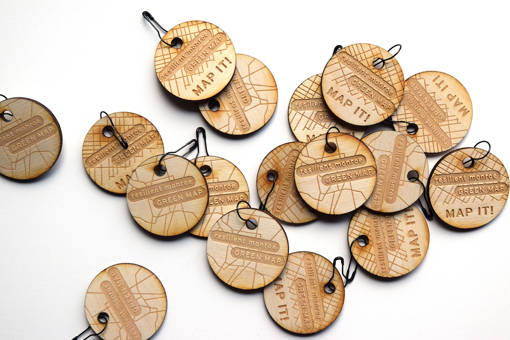 wood chips that were rounded and carved into with string at the top looking like keychains