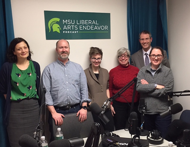 image of 4 women and 2 men posing for a picture inside the liberal arts endeavor podcast studio