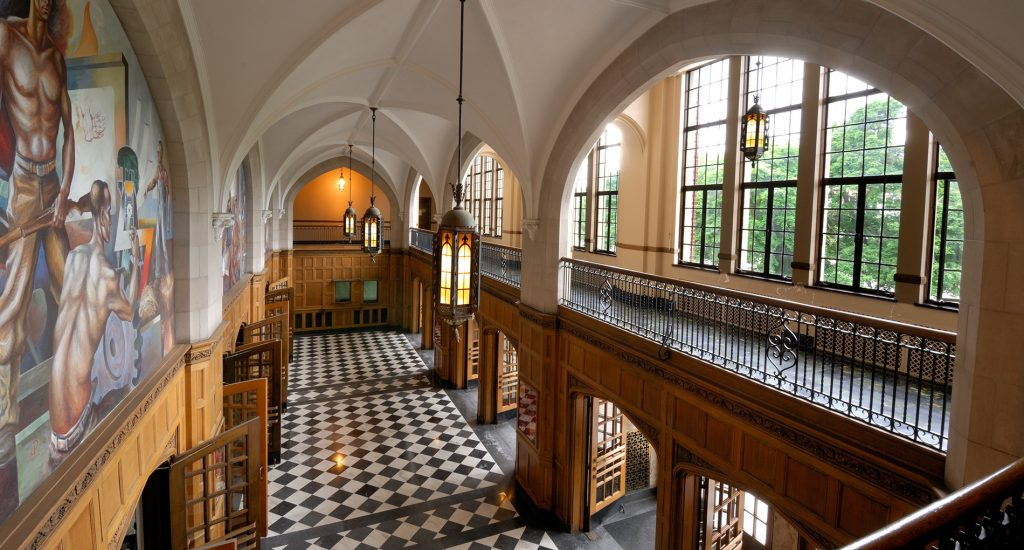 inside of a building with archways and lantern-like lights and checkered floors
