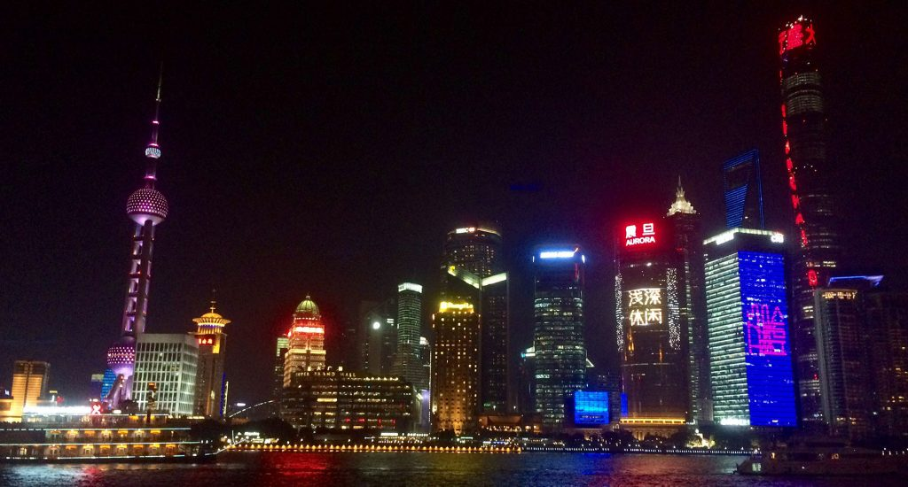 Brightly colored skyline over the water in China