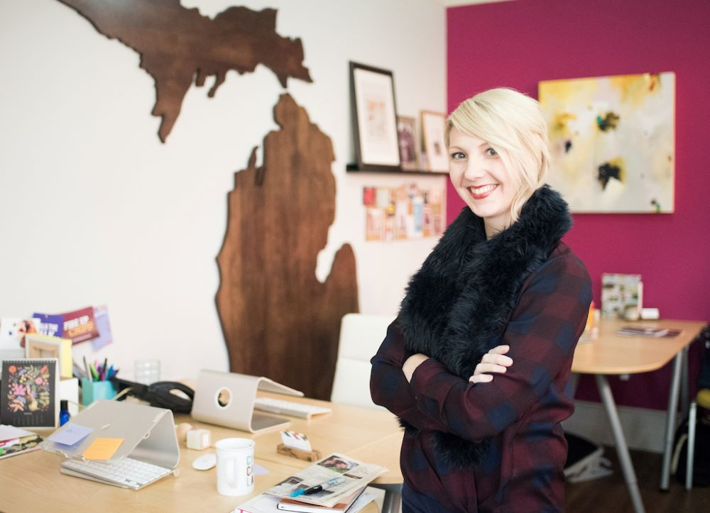 Woman with blonde hair standing in her office