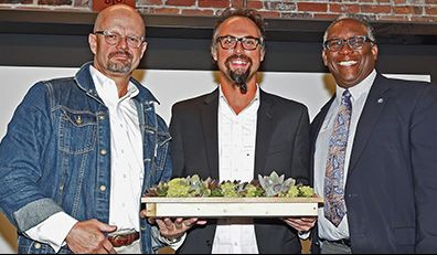 3 men all with glasses posing for picture