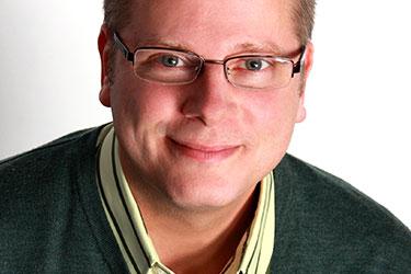 Rob Roznowski: a man with glasses