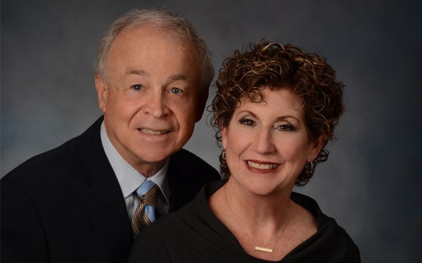 Portrait of a man and a woman smiling at the camera