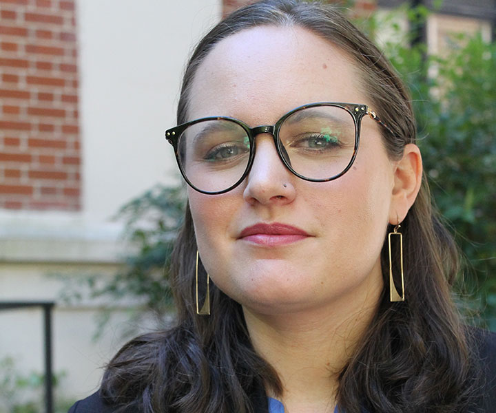 headshot of woman with glasses