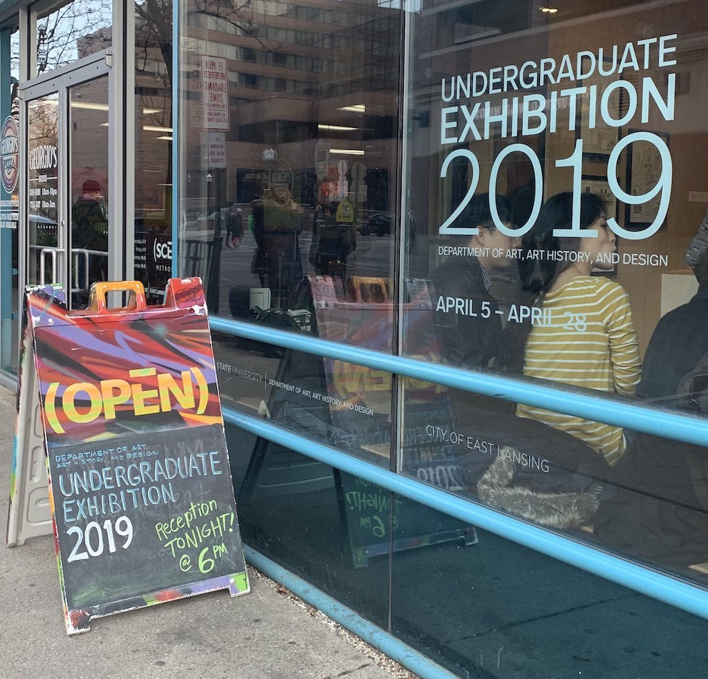 photo of a window that has a sticker that says 'undergraduate exhibition 2019'