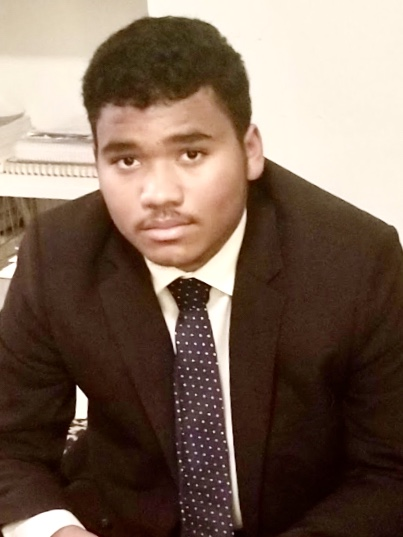 Man in a suit looking at the camera
