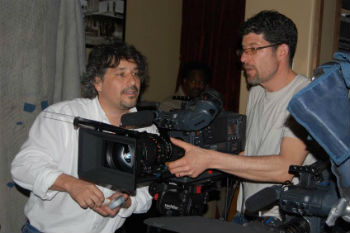 two people looking at camera equipment