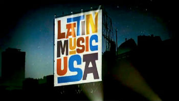 sign that says Latin Music USA in colorful letters
