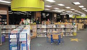 Photo of a room filled with books on shelves and carts