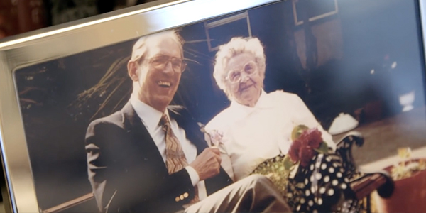 picture of a framed photo of man and woman sitting together