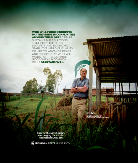 A Spartan branded poster that shows a man leaning against a shed structure in an agricultural field