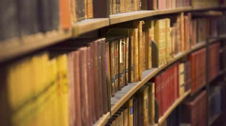 old books lined up on a shelf