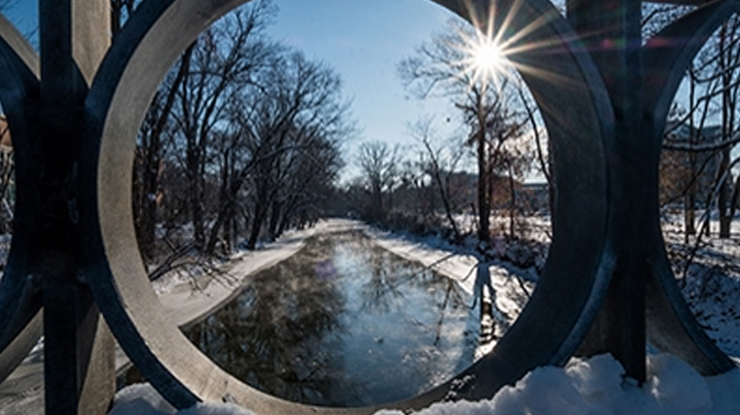 View of red cedar river, during winter from a bridge