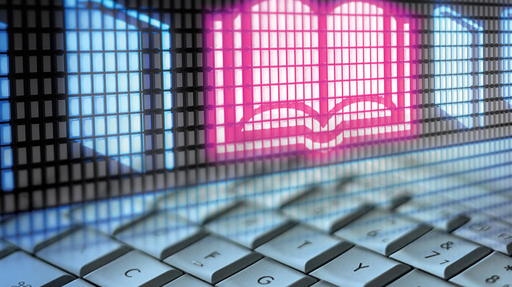 a keyboard and a neon sign of a book