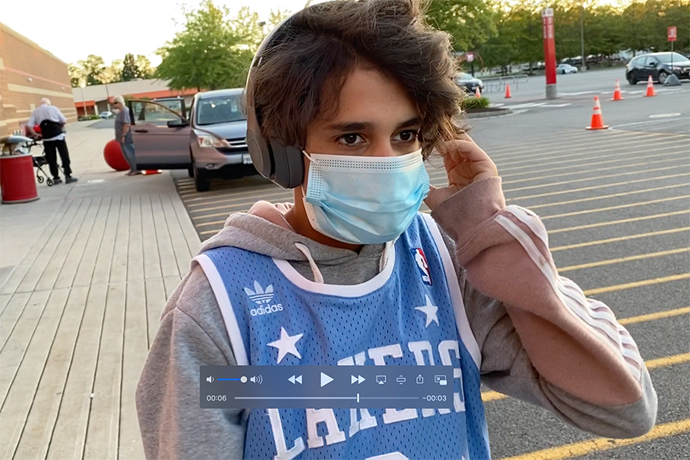 a boy wearing a jersey and a mask with headphones