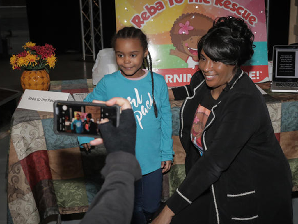 a women and a child taking a photo together