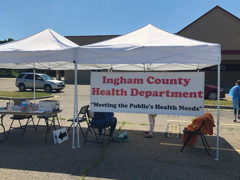 Tent with a signs that says Ingham County Health Department