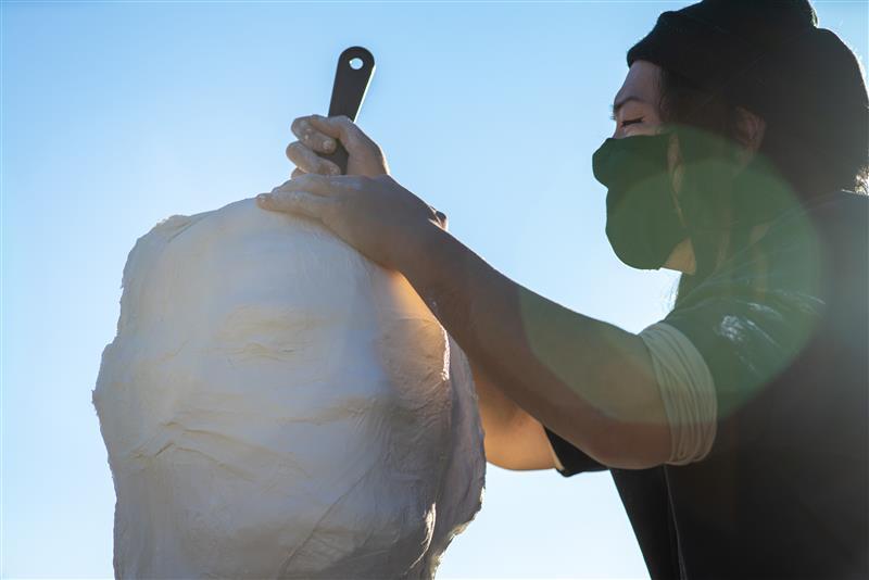 a person doing papier mâché