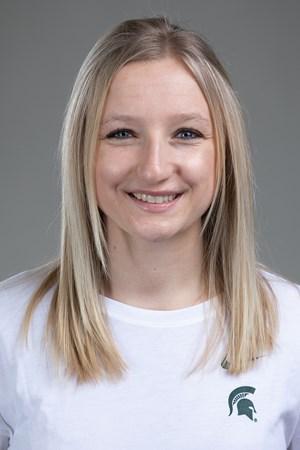 headshot of a girl with long blonde hair wearing a MSU shirt